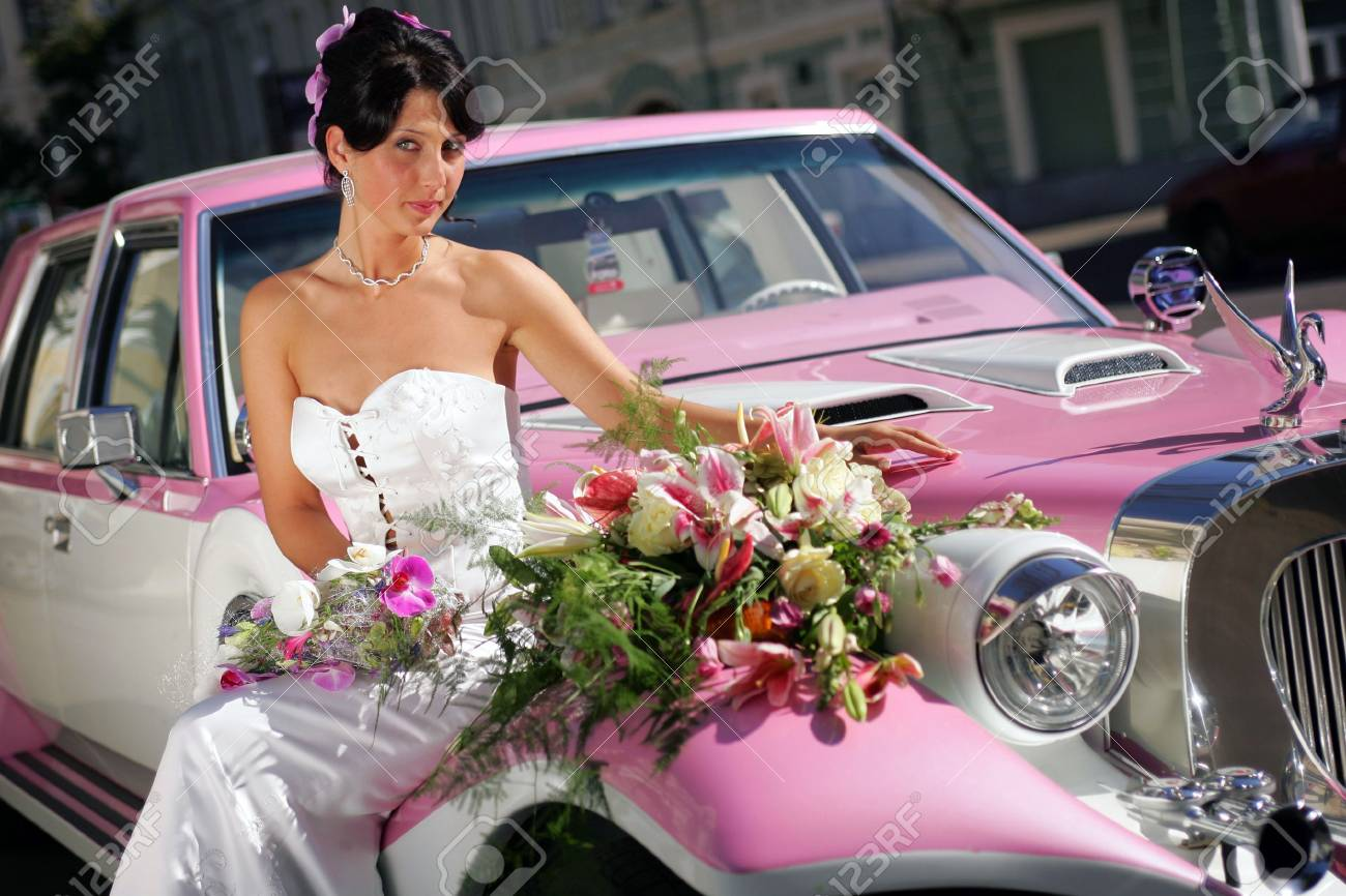 pink limousine with bride on hood Stock Photo - 2536755
