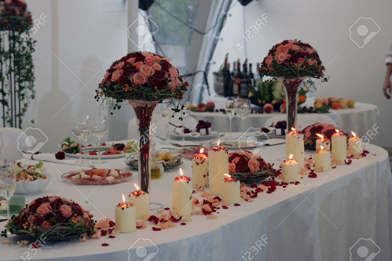 Beautifully Decorated Place Settings On Head Table At Wedding