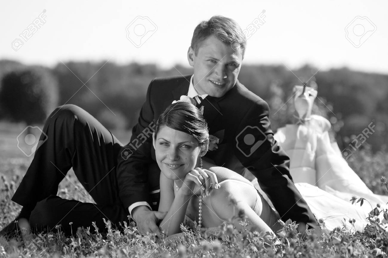 Bride and groom newlyweds seen here on their wedding day, Bride is wering a traditional white wedding dress Stock Photo - 2678586