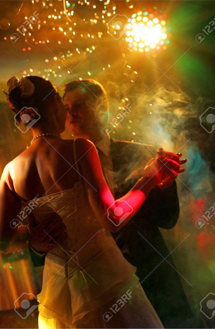 Newlywed couple dancing at their wedding reception. Stock Photo - 3869020