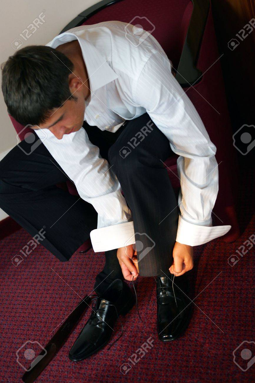 Close up of young businessman tying shoe laces. Stock Photo - 4678367