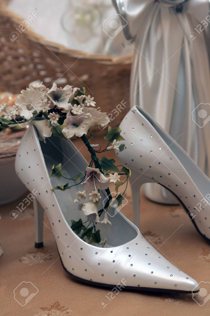 Closeup of luxurious silver bridal wedding shoes indoors. Stock Photo - 6110435