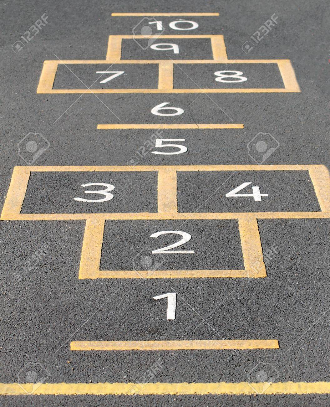Hopscotch game painted on a school playground. - 19427722