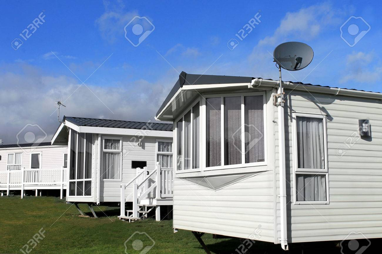 Scenic view of a caravan or trailer park in summer with blue sky and cloudscape background. - 35080063