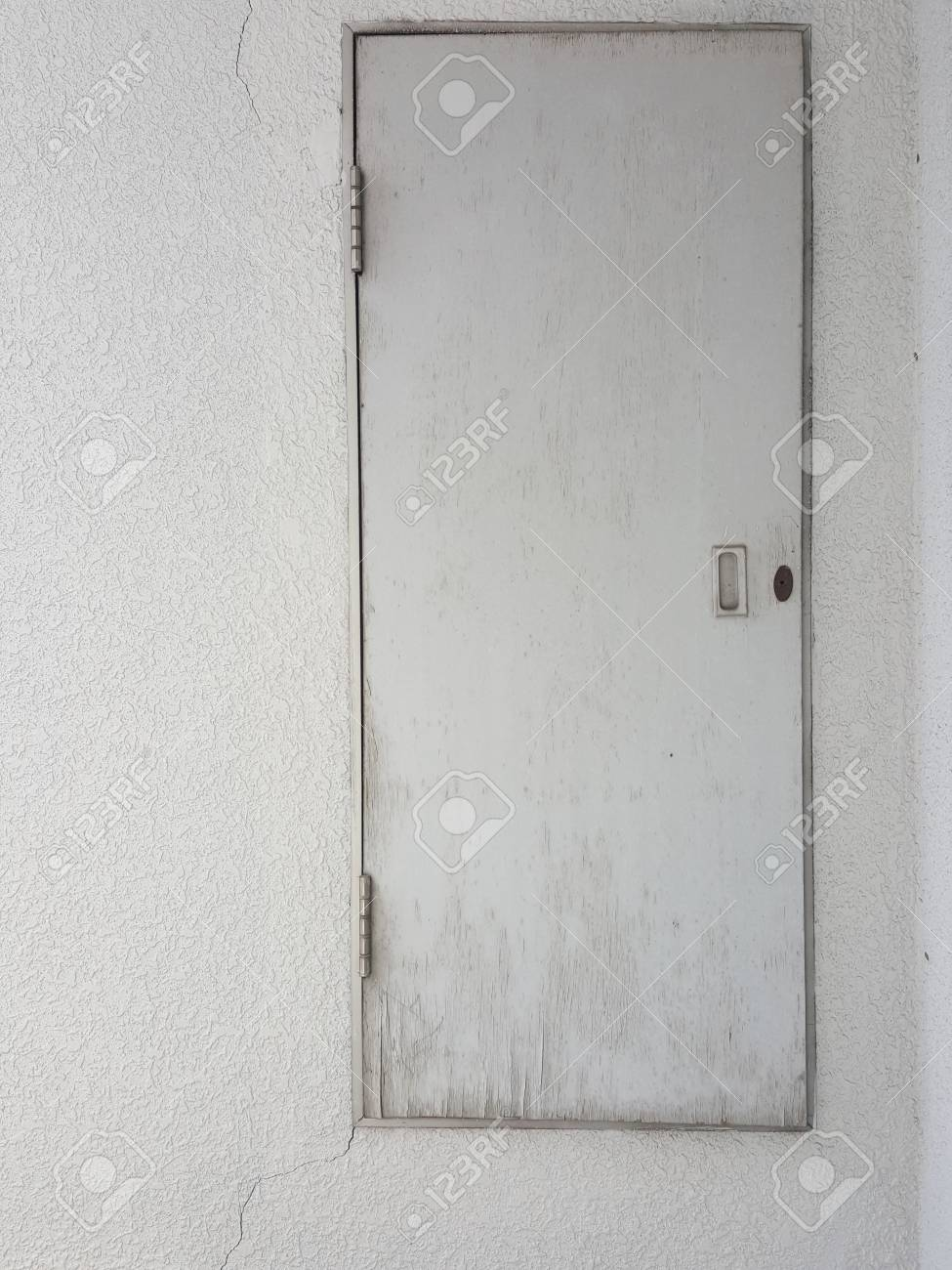 Wood Door On The White Concrete Wall Texture Stock Photo Picture