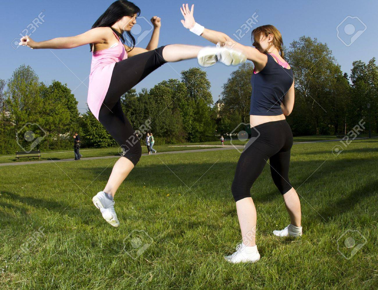 Karate fight between young girls in the park Stock Photo - 9390339
