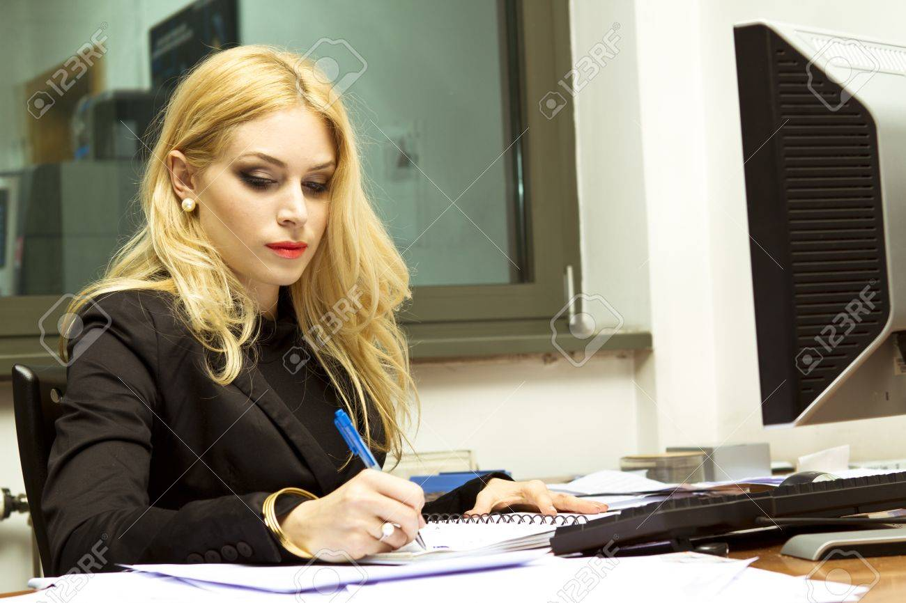 secretary in the office writing a letter stock photo picture and