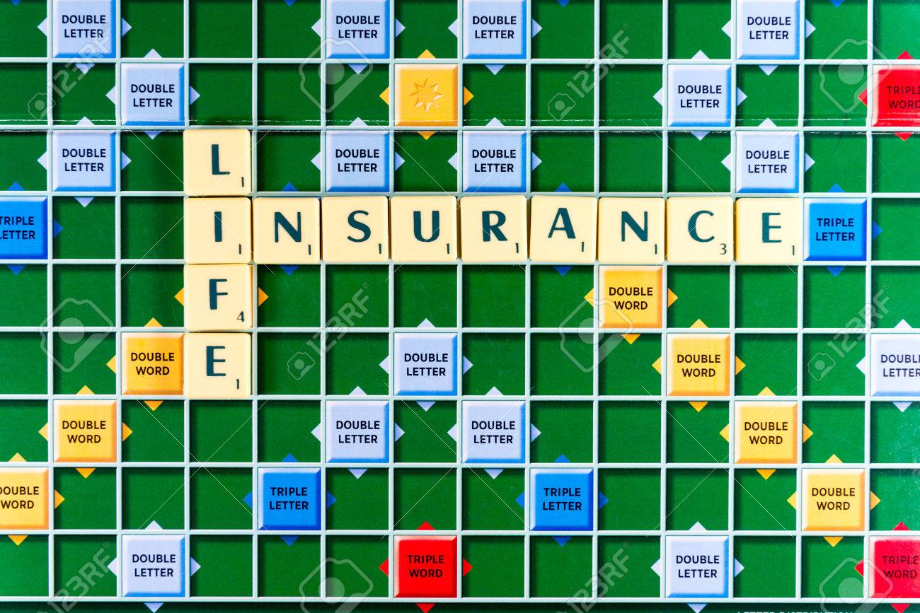 Life Insurance Crossword On The Colorful Game Board Stock Photo