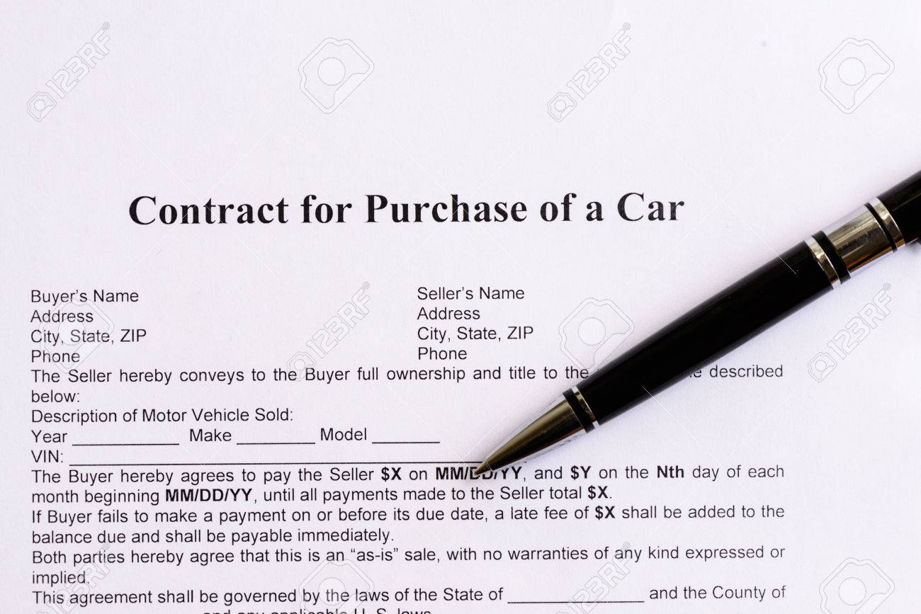 Contract For Purchase Of A Car On The White Paper With Pen Stock ...