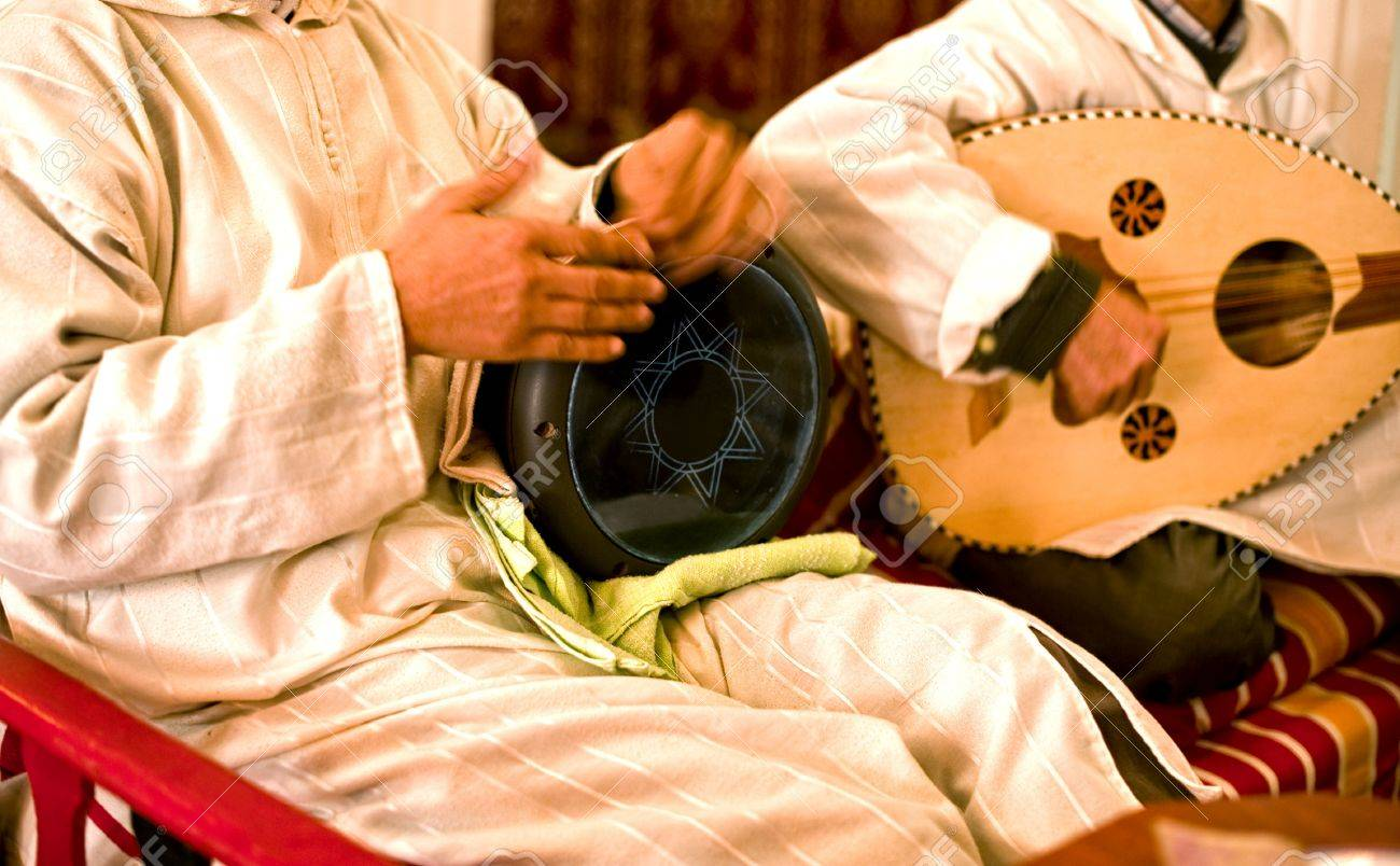 Musicians playing music on traditional arabic instruments