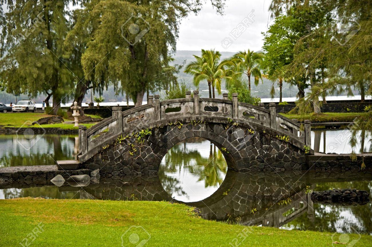 Japanese Garden Stone Bridge stone bridge in the japanese garden hilo, hawaii stock photo