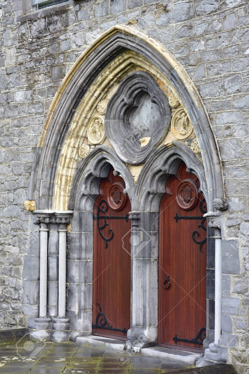 Portrait View Of Arched Dual Gate With Wooden Doors On Metal