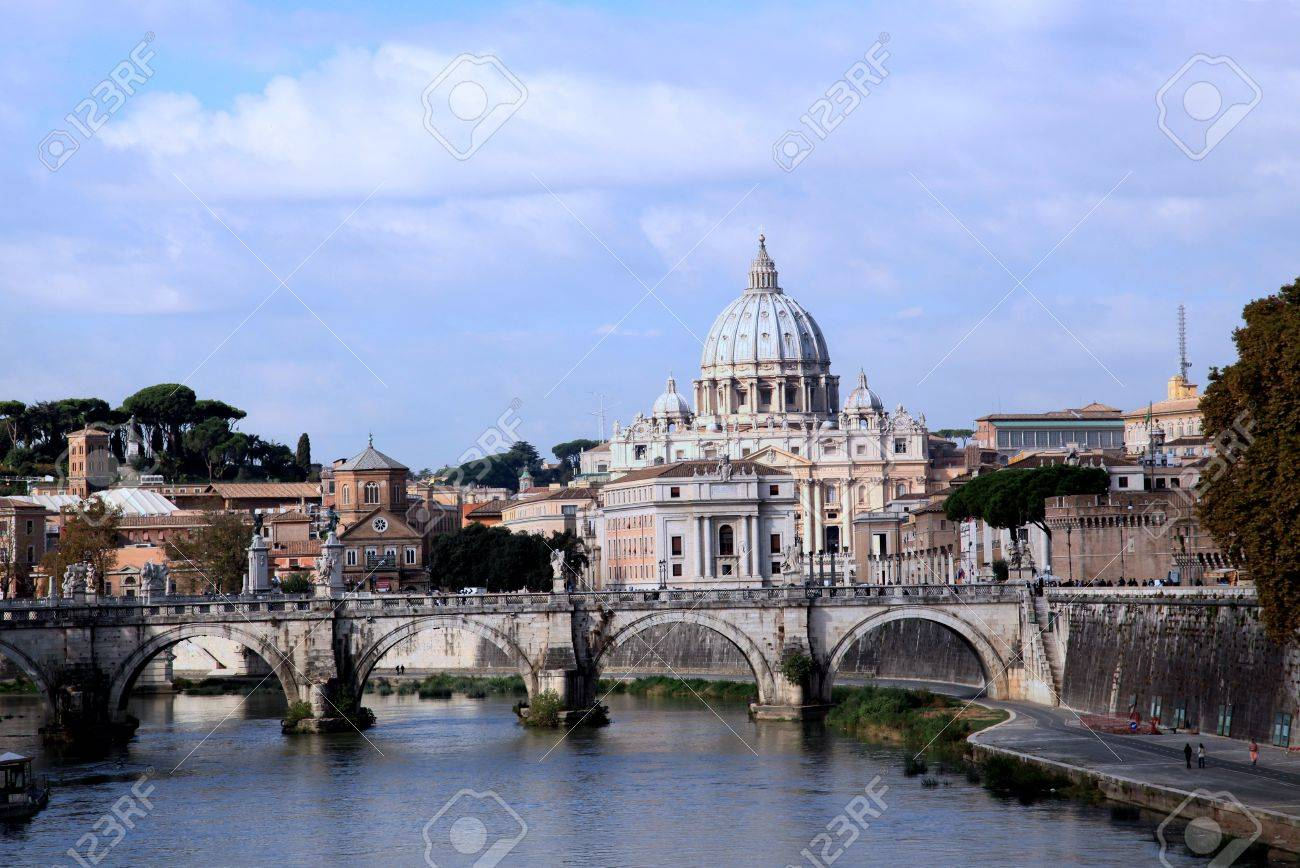 Rome, Italy, October 2011 - Skyline looking over the Tiber River, with Dome of St. Peter Stock Photo - 10912420