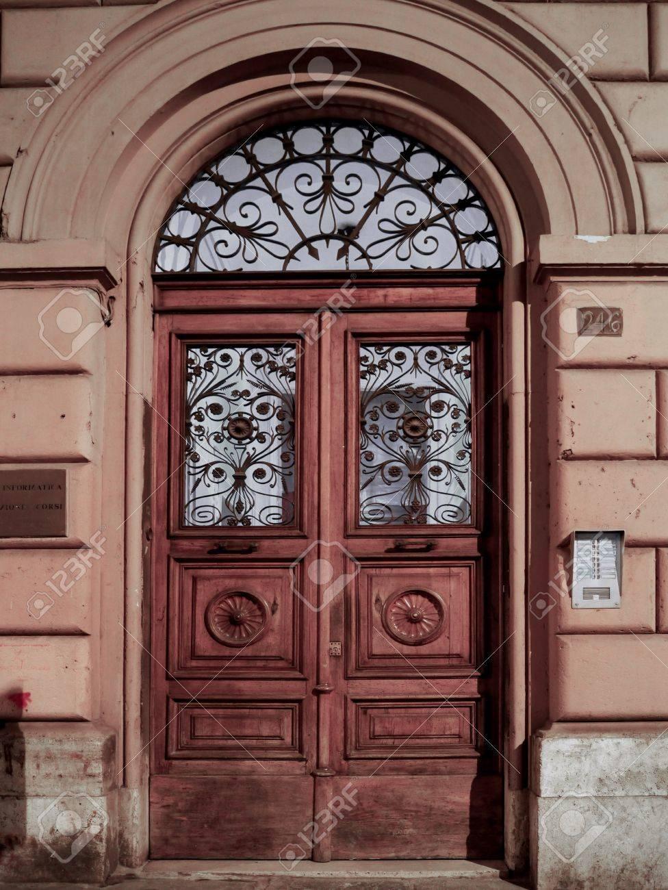 Apartment Building Door rome, italy, october 2011 - wooden double door of old apartment