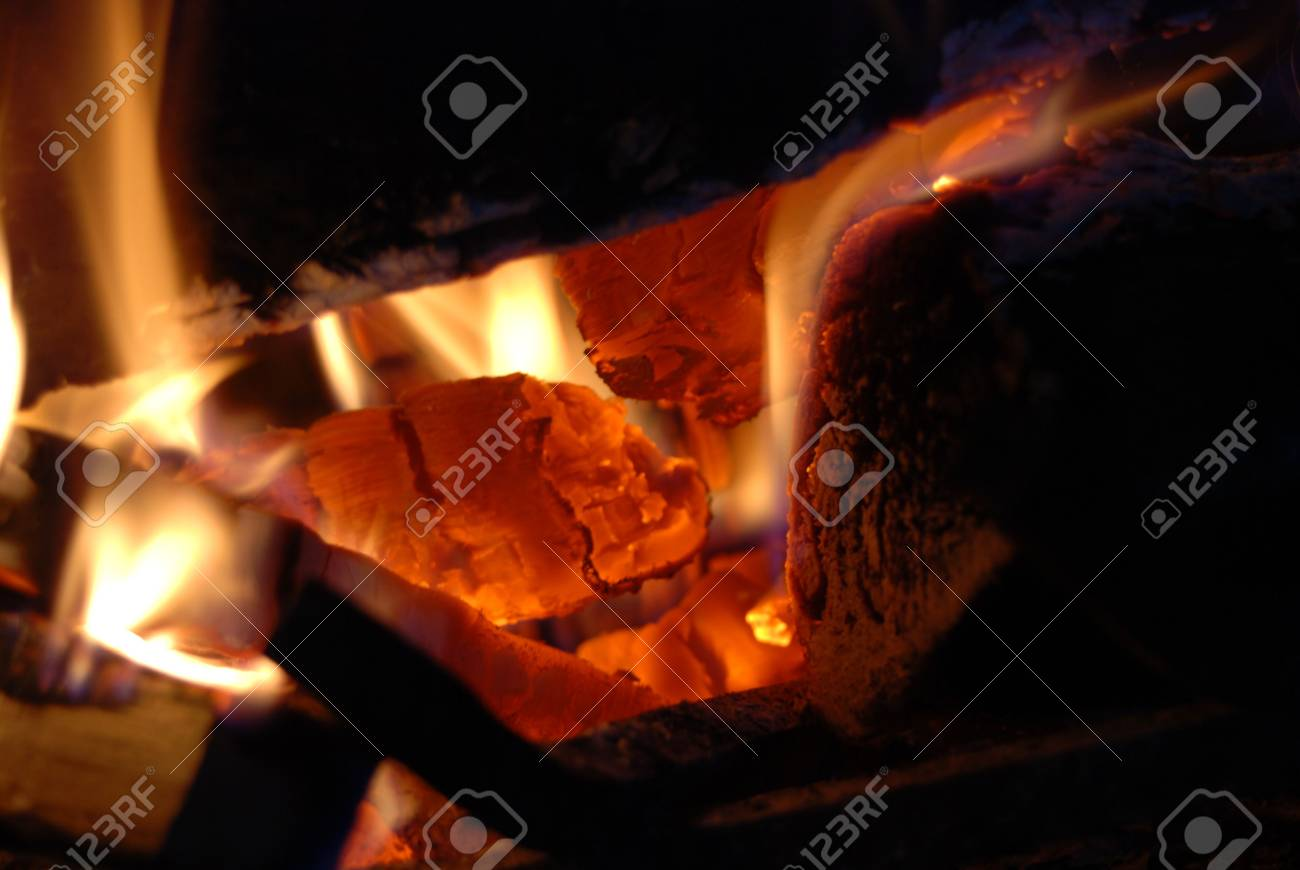 Burning wood with beautiful flames in a fireplace. Stock Photo - 3863669