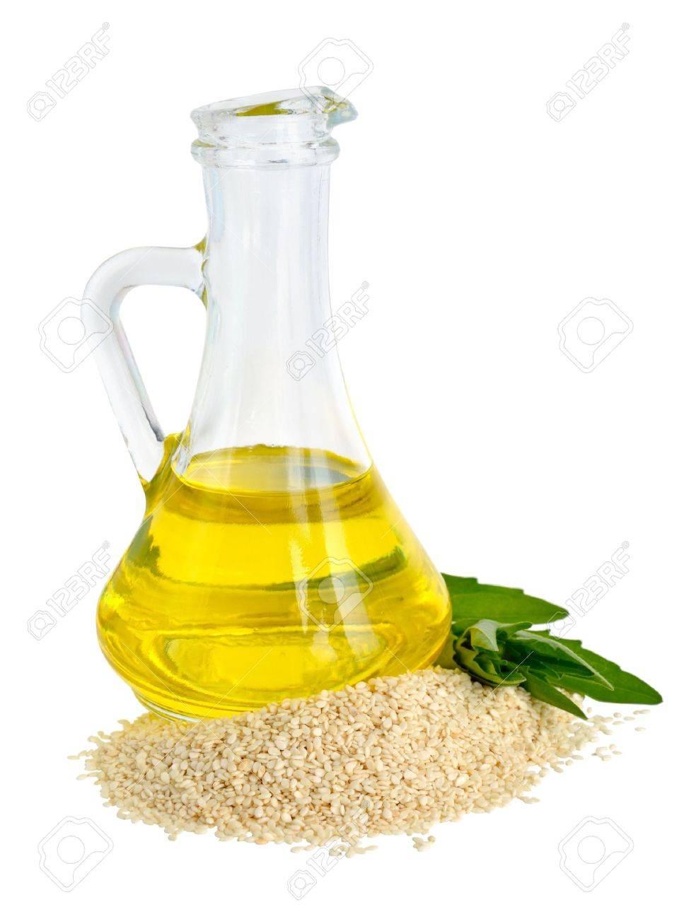 Sesame oil oil in a glass jug. - 21874989