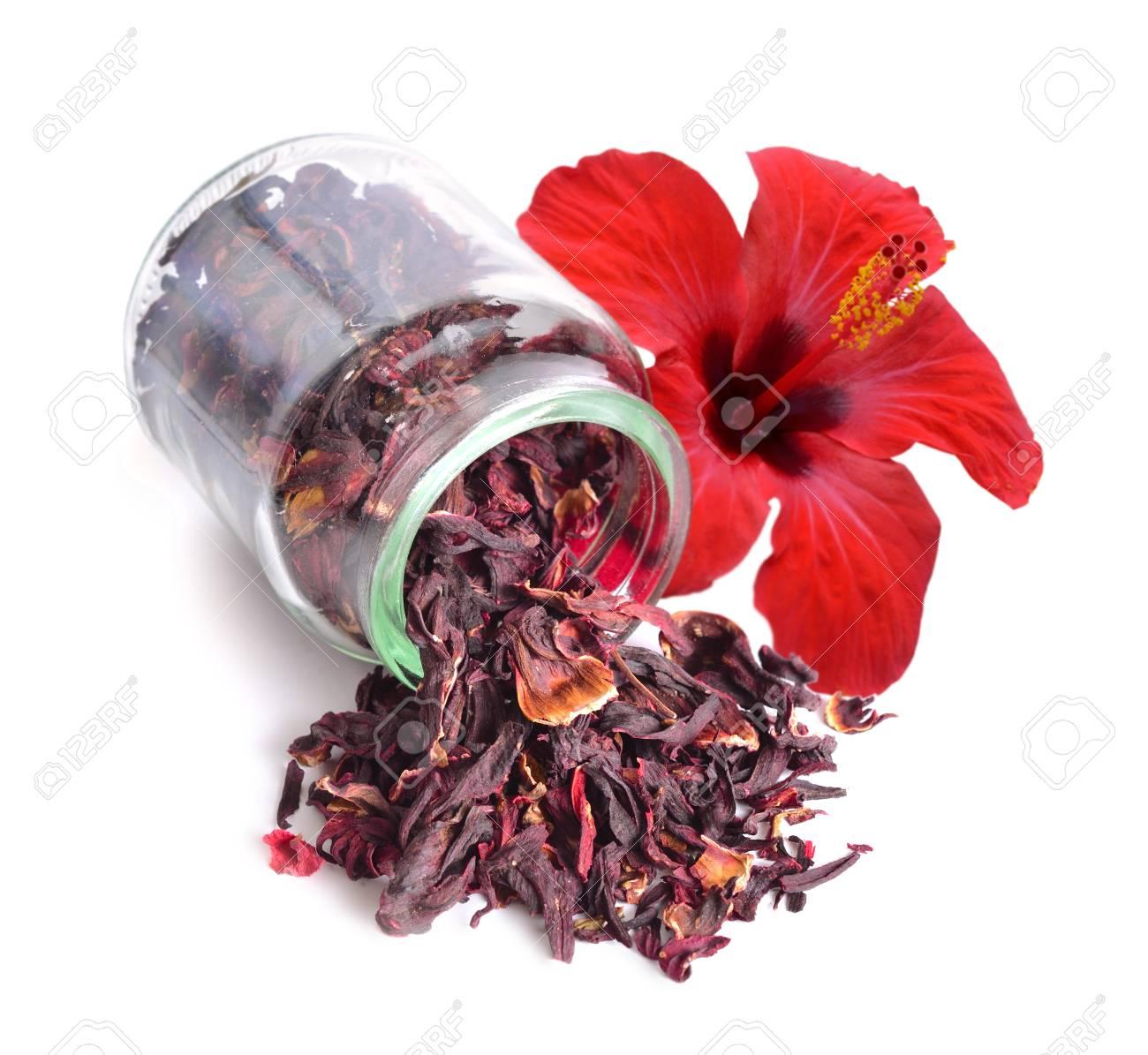 Dry hibiscus tea in glass jar with flower isolated on white stock dry hibiscus tea in glass jar with flower isolated on white background stock photo izmirmasajfo