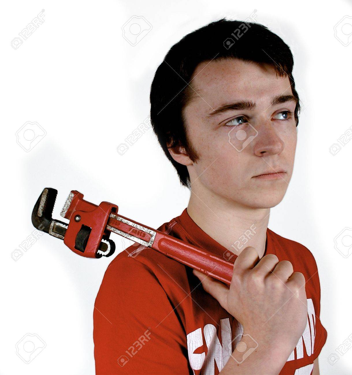 Young worker holding a wrench thinking about the job to be done Stock Photo - 2405434