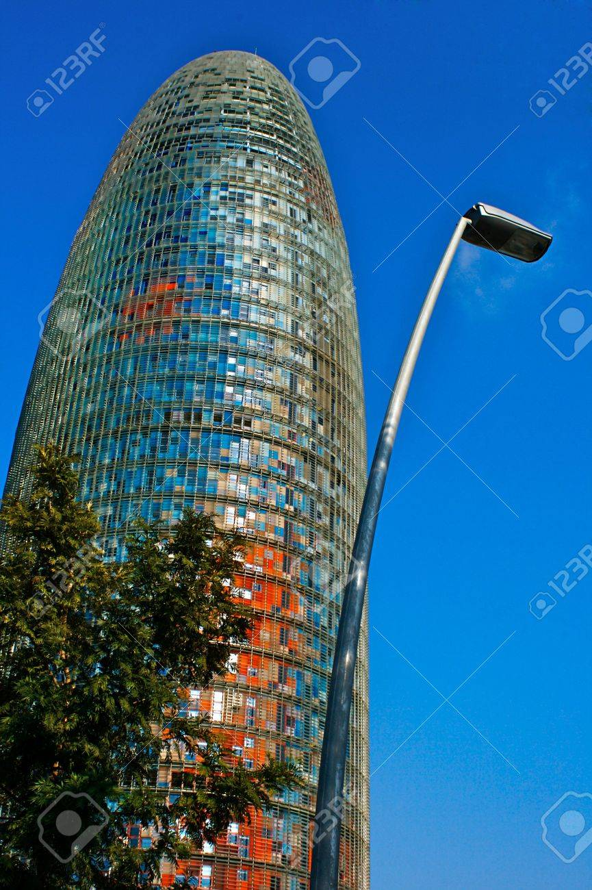 Bullet Shaped Modern Architecture In Barcelona With Lampost Stock
