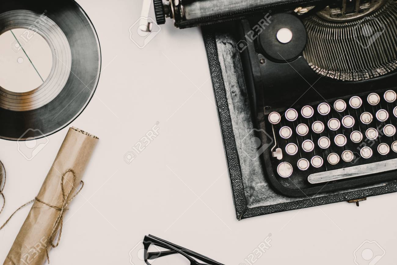 Stock Photo   Vintage Office Desk With Camera, Typewriter And Accessories