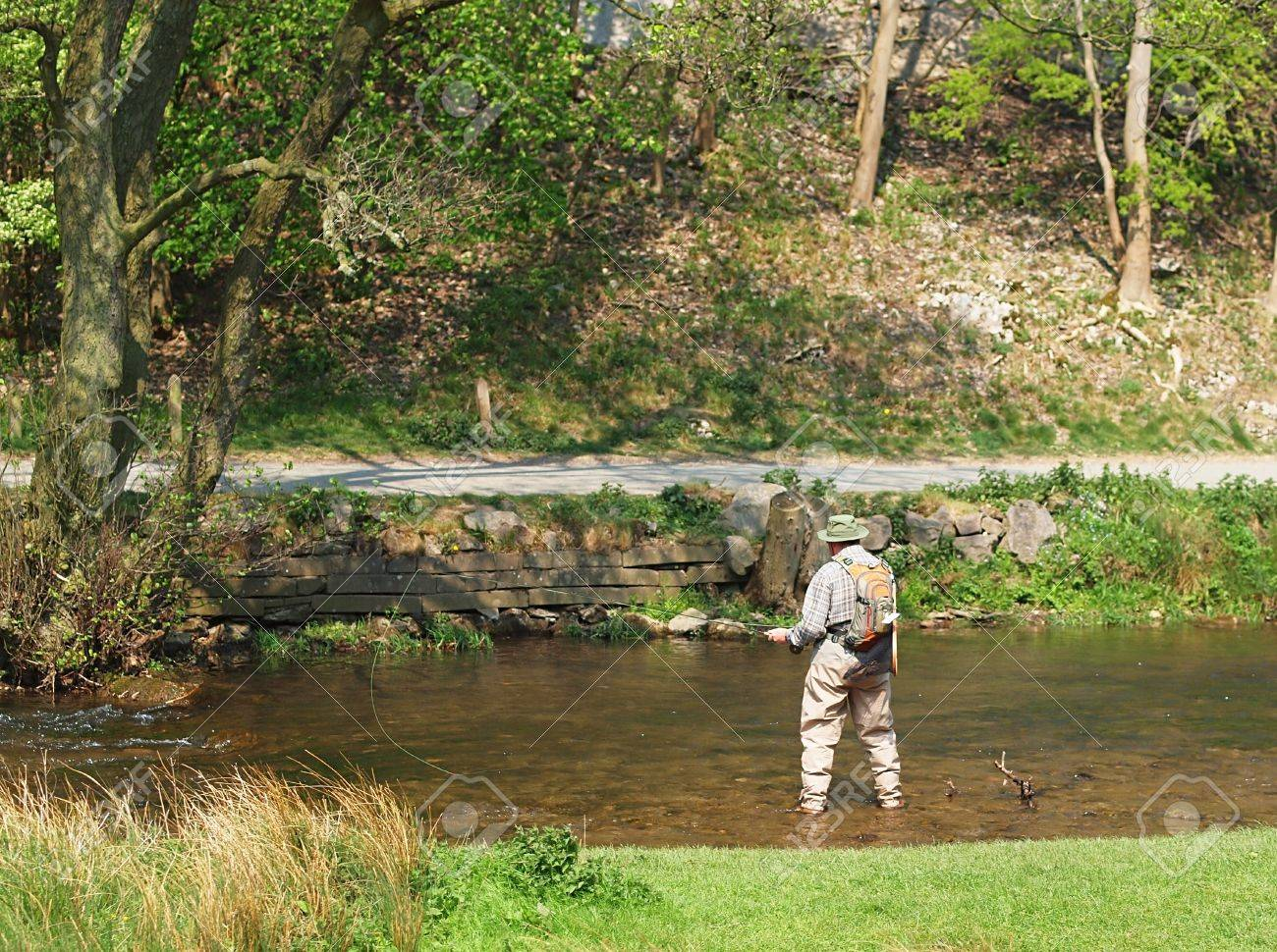 Fly fishing, River Dove, Dovedale on the Staffordshire Derbyshire border Stock Photo - 9448110