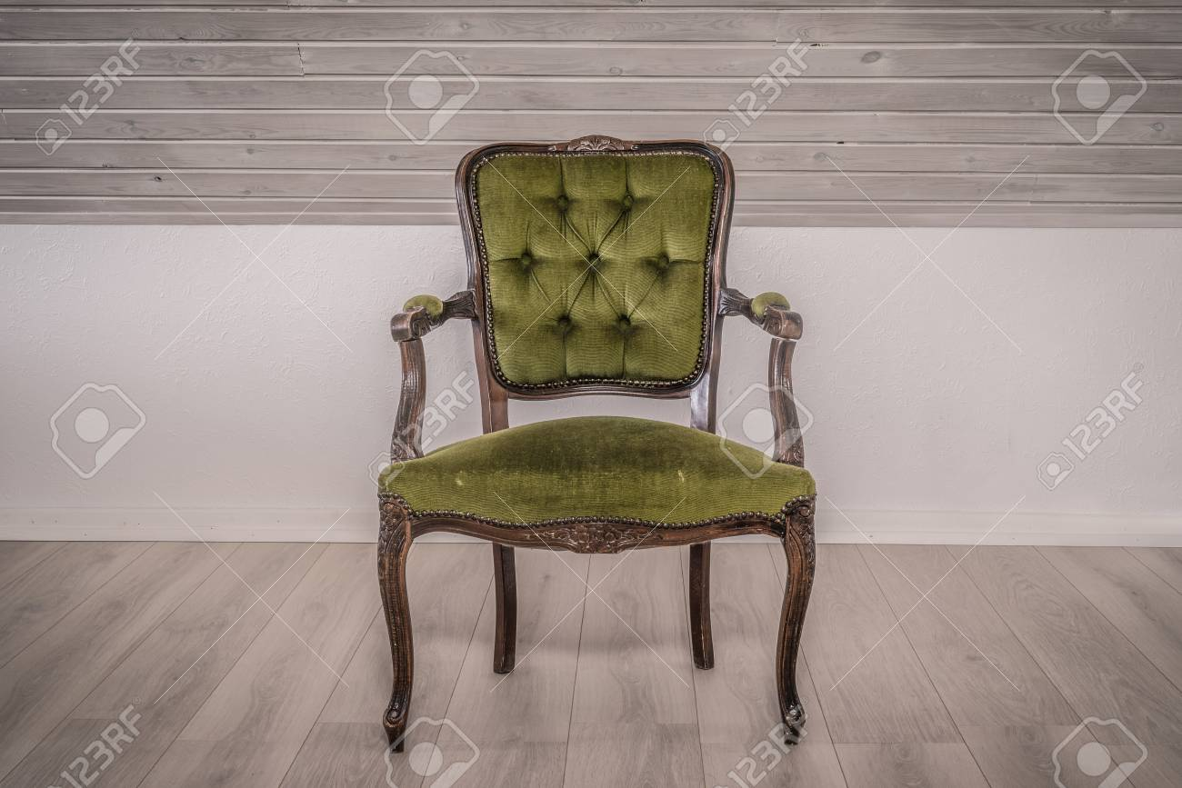 Green Chair In Victorian Style On Wooden Floor Stock Photo