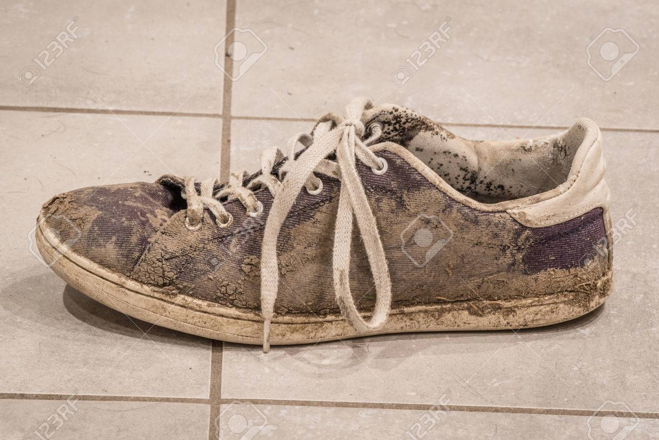 Dirty Shoe With White Laces Covered