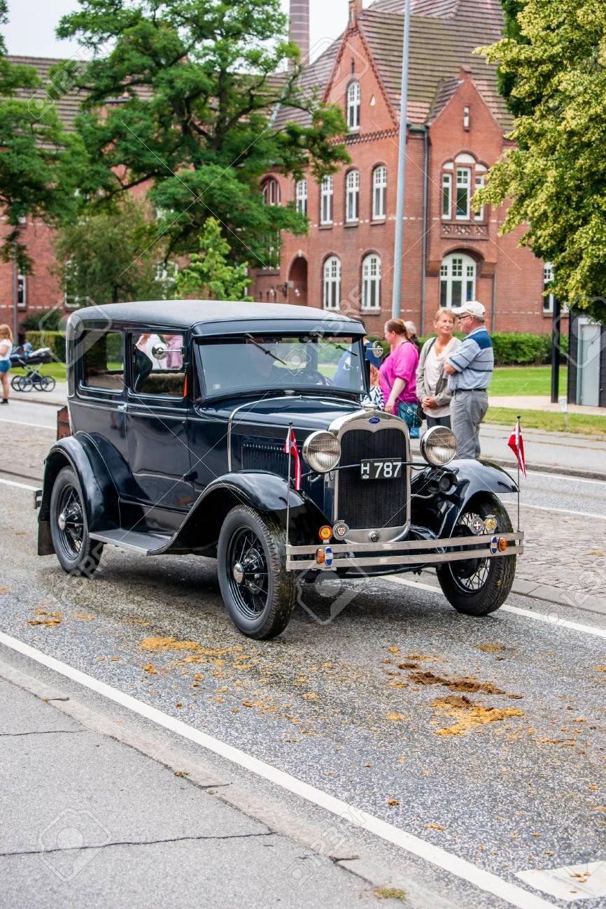 AABENRAA, DENMARK - JULY 6 - 2014: Veteran car at a parade at