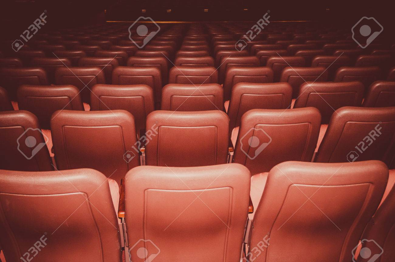 Movie theatre seats in red colors in a dark room stock photo movie theatre seats in red colors in a dark room stock photo 61105813 freerunsca Gallery