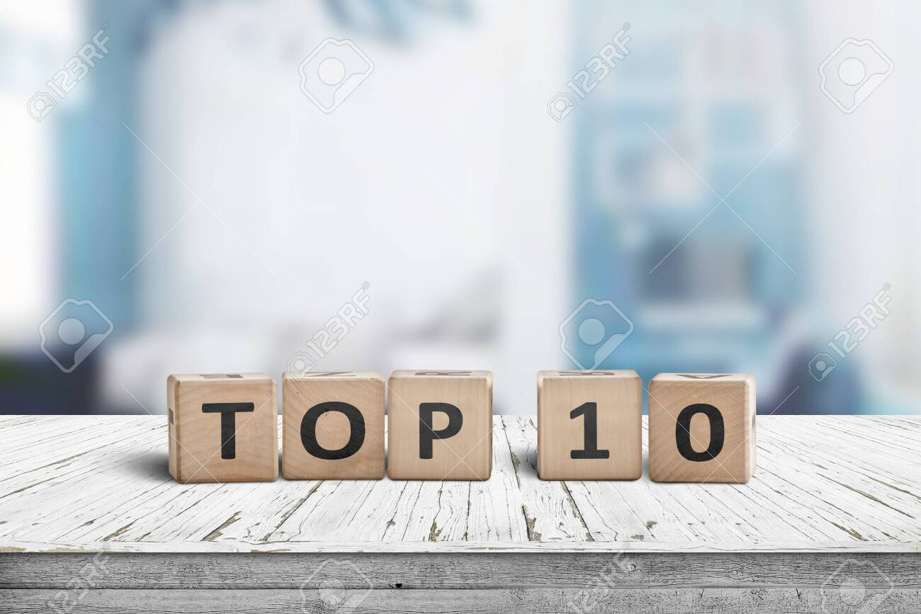 Top 10 sign made of wooden dices on a table i a bright environment with blue colors - 142611397