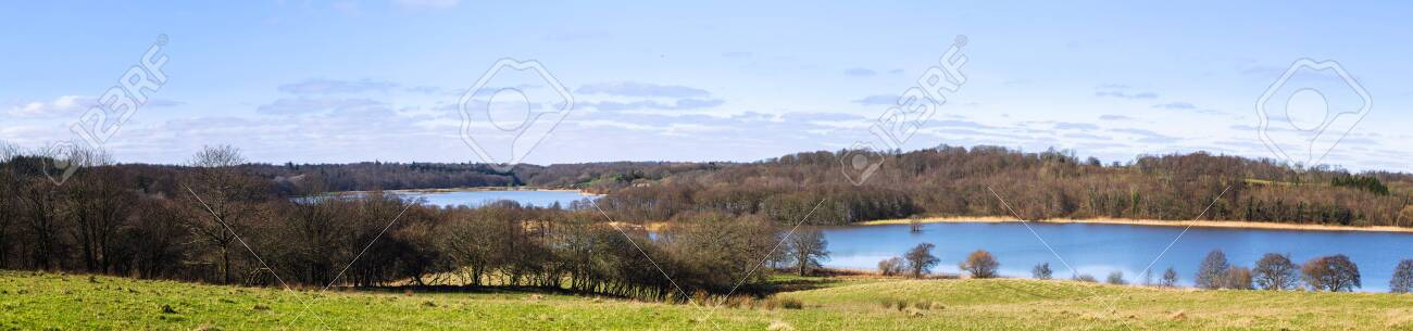 Panorama landscape with blue lakes and green meadows in the autumn - 142232403