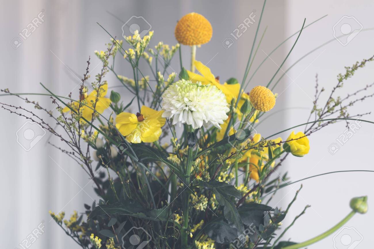 Bouquet of colorful flowers in yellow and orange variations in the springtime - 145302158