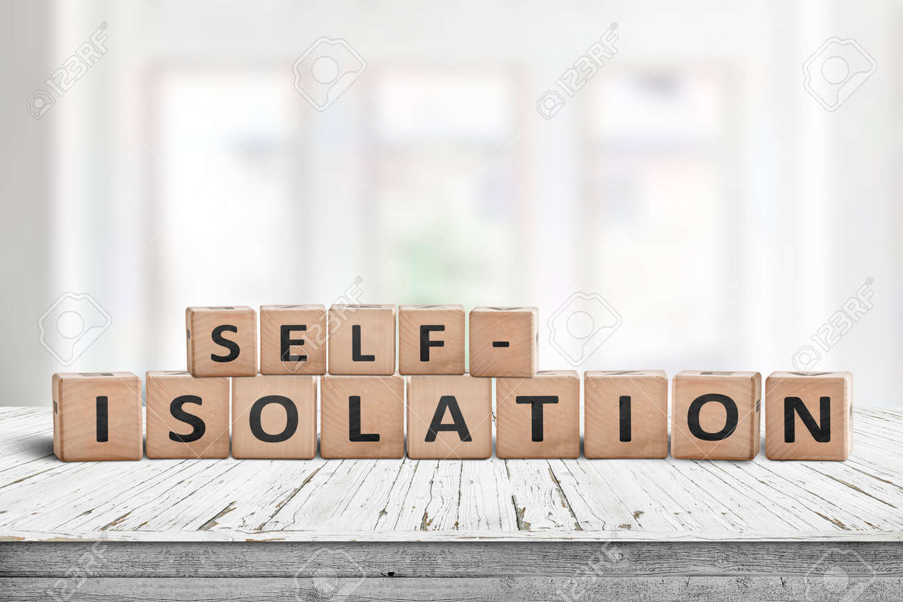 Self-isolation sign on a desk in a bright living room on a sunny day - 146668798