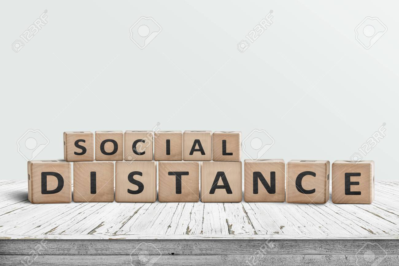 Social disctance information sign made of blocks on a wooden table - 146668808