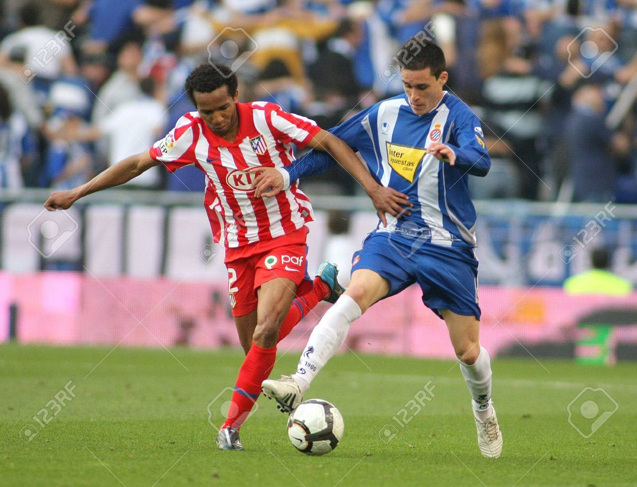 Assunçao(L) of Atletico Madrid fight with Callejon(R) Espanyol during a Spanish League match between  Espanyol and Atletico Madrid at the Estadi Cornella on April 11, 2010 in Barcelona, Spain Stock Photo - 9082135