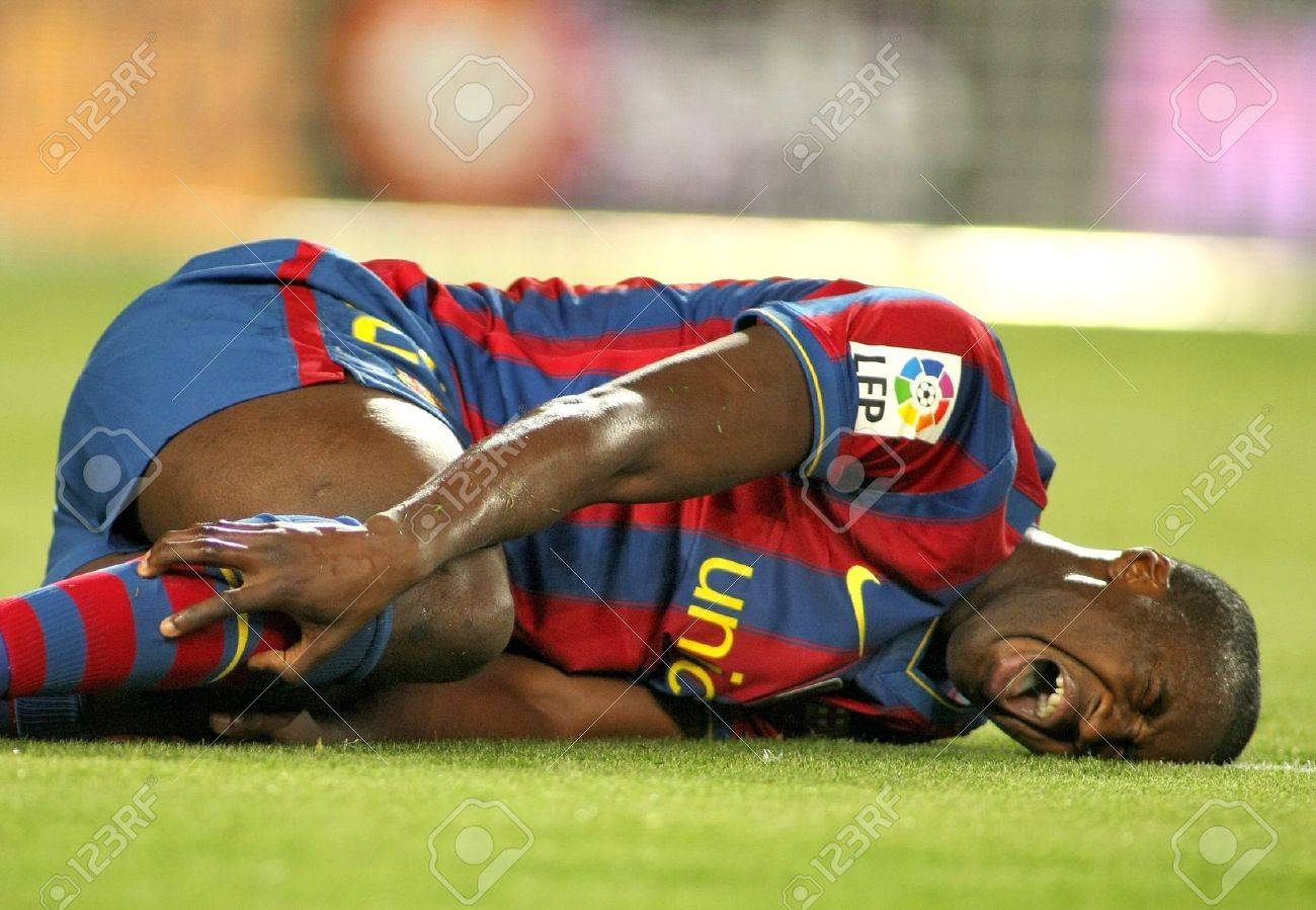 Toure Yaya of Barcelona injured during a Spanish League match between FC Barcelona and Athletic Bilbao at the Nou Camp Stadium on April 3, 2010 in Barcelona, Spain Stock Photo - 7405229