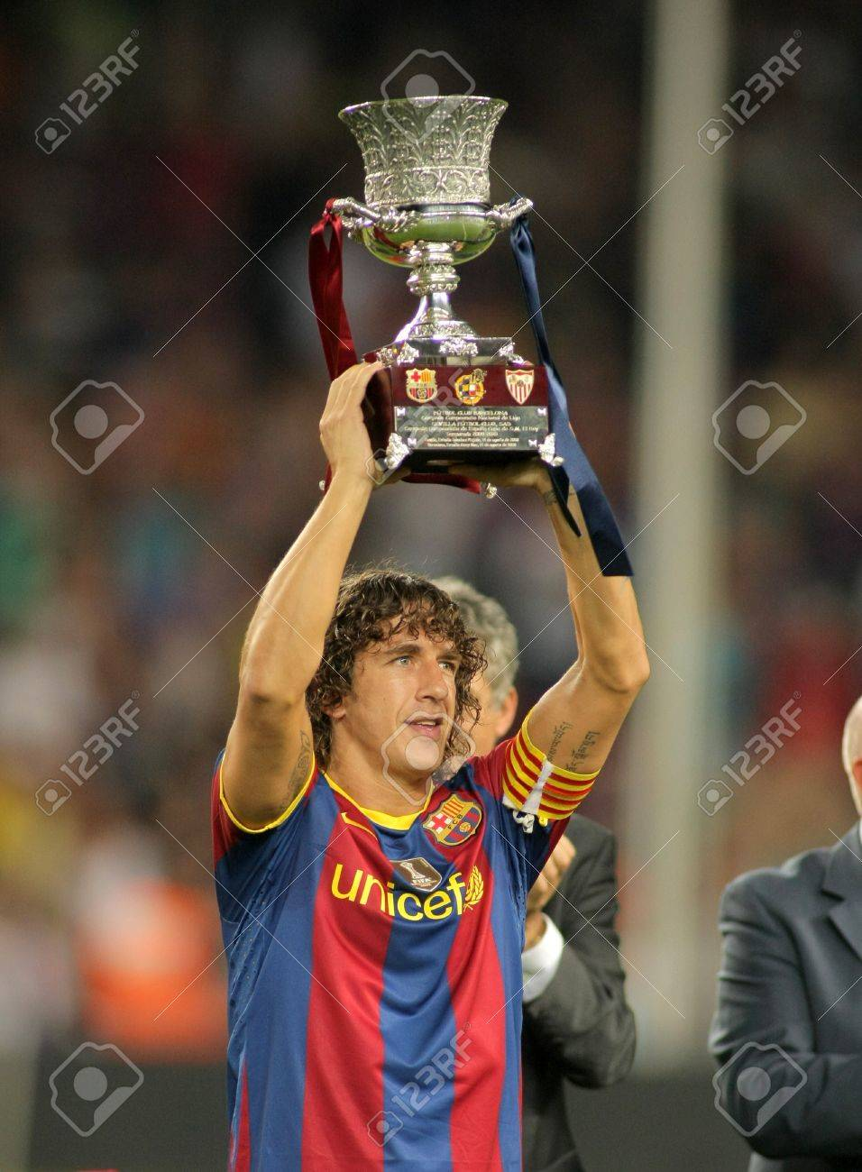 Carles Puyol Barcelona Holds Up The Spanish Super Cup After