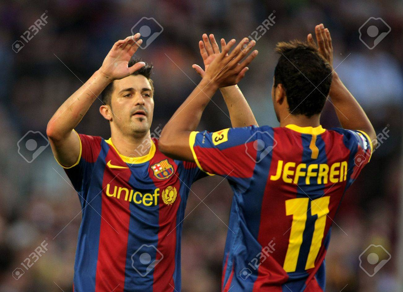 Villa and Jeffren of Barcelona celebrating goal  during the match between FC Barcelona and Osasuna at the Nou Camp Stadium on April 23, 2011 in Barcelona, Spain Stock Photo - 9684216