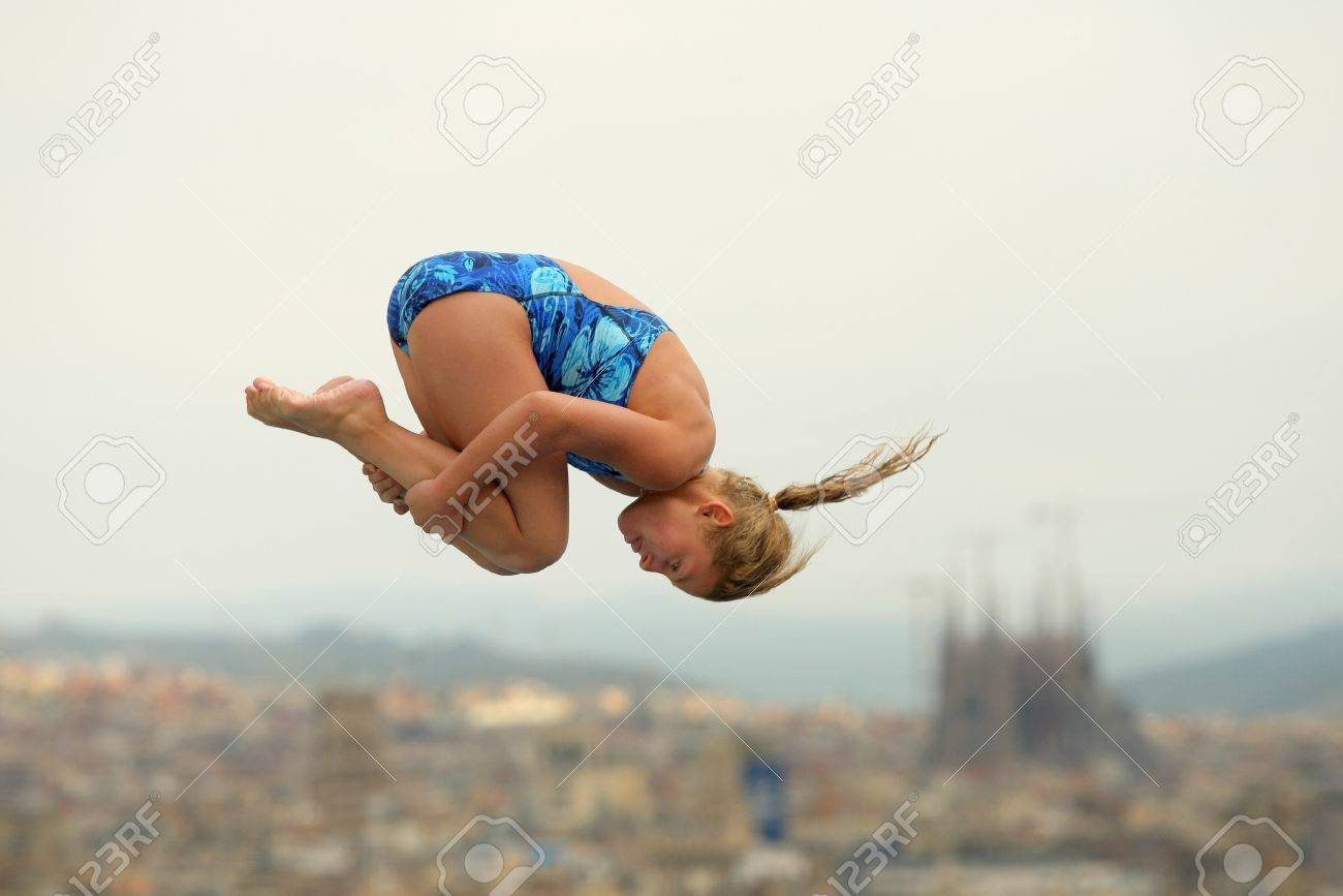 Diving athlete in action during a competition  of Barcelona diving trophy at Monjuich swimming pool July 24, 2011 in Barcelona, Spain Stock Photo - 10499627