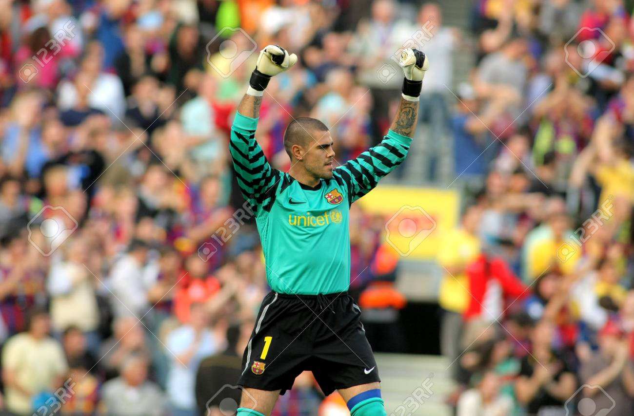 Victor Valdes of FC Barcelona celebrates goal  during the match between FC Barcelona and RCD Espanyol at the Nou Camp Stadium on May 8, 2011 in Barcelona, Spain Stock Photo - 10558887