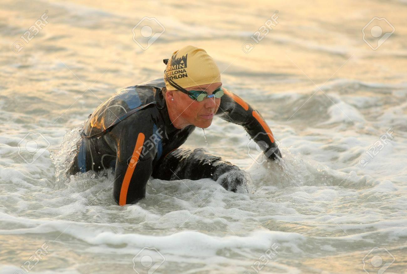 Michelle Vesterby of Denmark in action finishing swimming at Barcelona Garmin Triathlon event at Barcelona beach on October 16, 2011 in Barcelona, Spain Stock Photo - 11366191