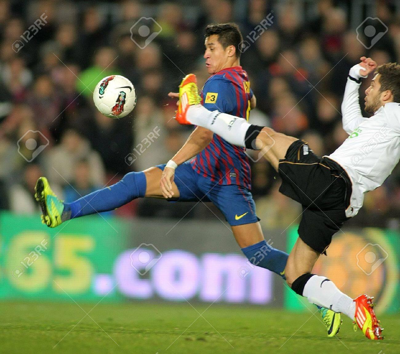 Alexis Sanchez L FC Barcelona Vies With Jordi Alba R