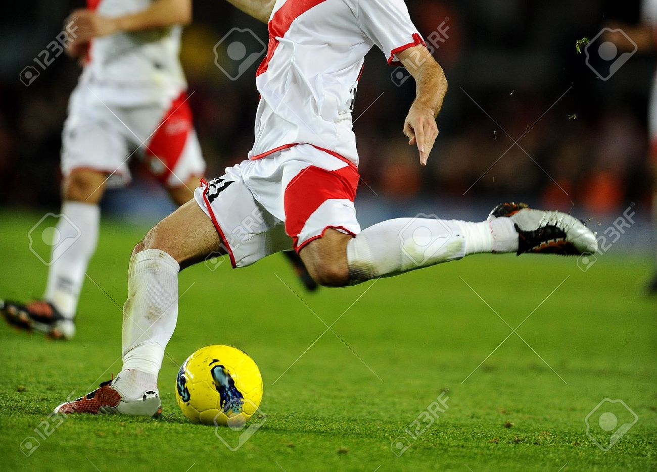 Soccer player legs in action Stock Photo - 14080704
