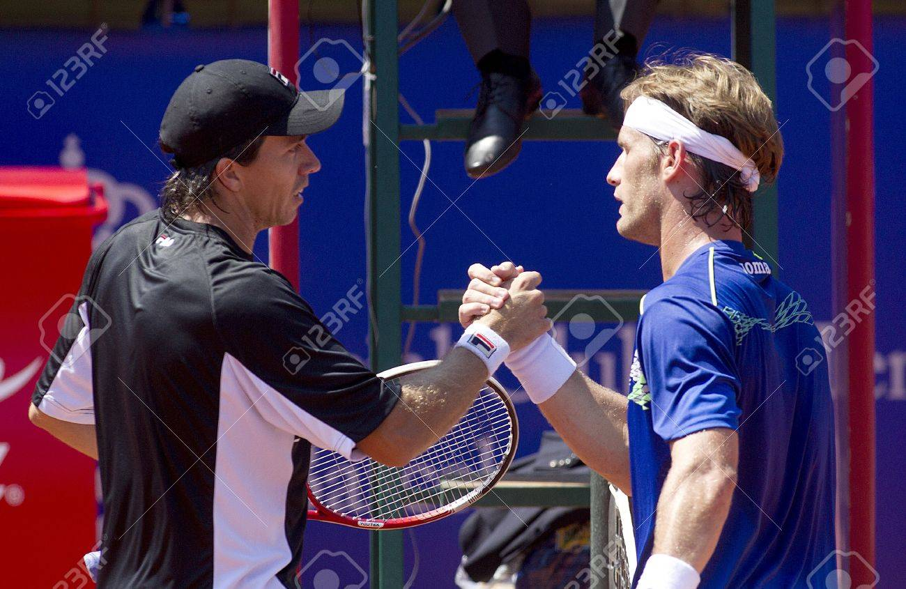 Argentinian tennis player carlos berlocq and spanish daniel gimeno argentinian tennis player carlos berlocq and spanish daniel gimeno traver greet each other after his m4hsunfo