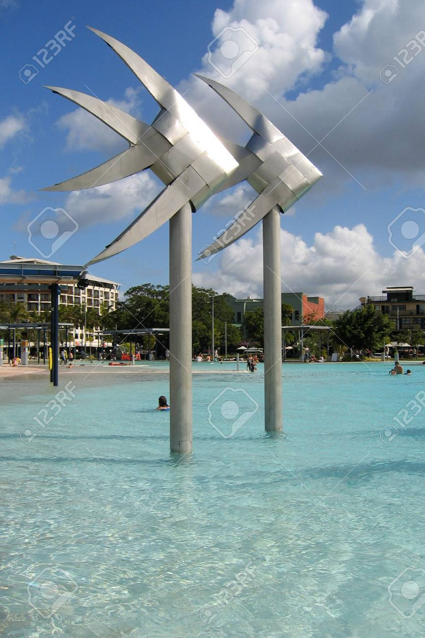 two fish sculptures in the community outdoor swimming pool.  Cairns Australia Stock Photo - 777718