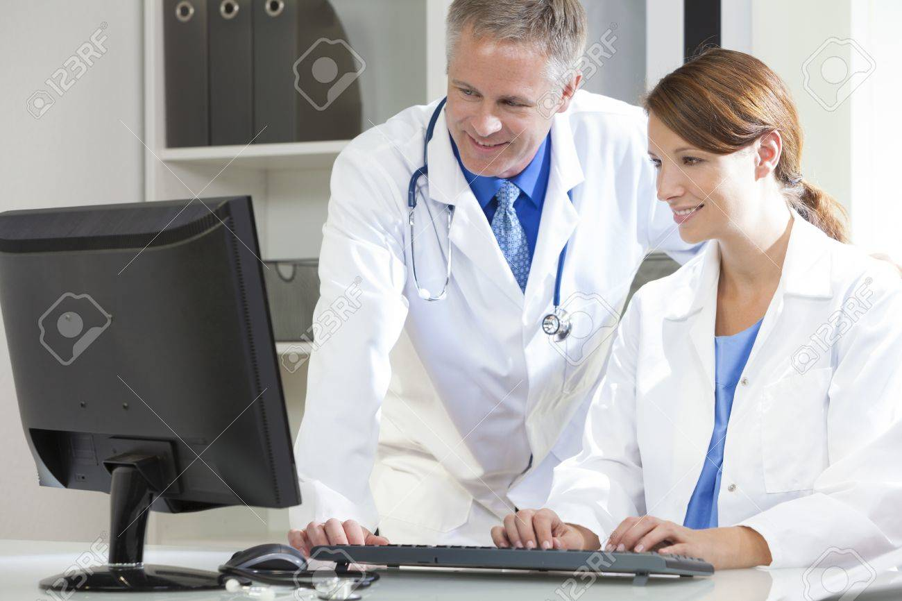 Male & female medical doctors using computer in a hospital office Stock Photo - 19563927