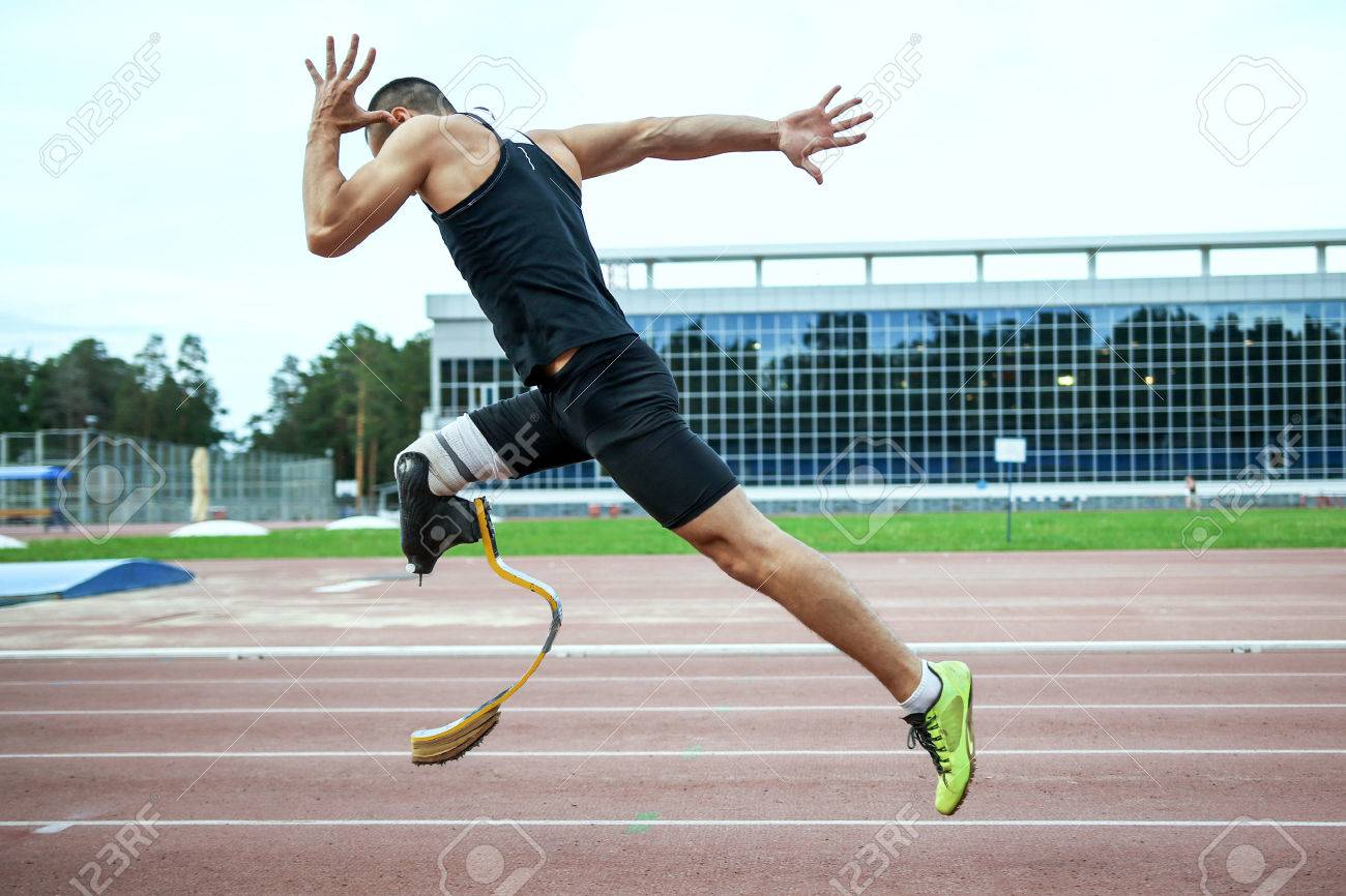 Explosive start of athlete with handicap at the stadium - 45346619