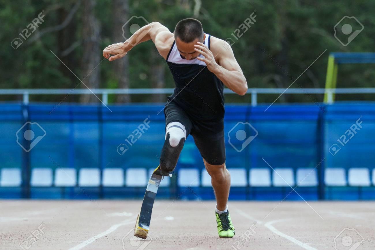 Explosive start of athlete with handicap at the stadium - 45347418
