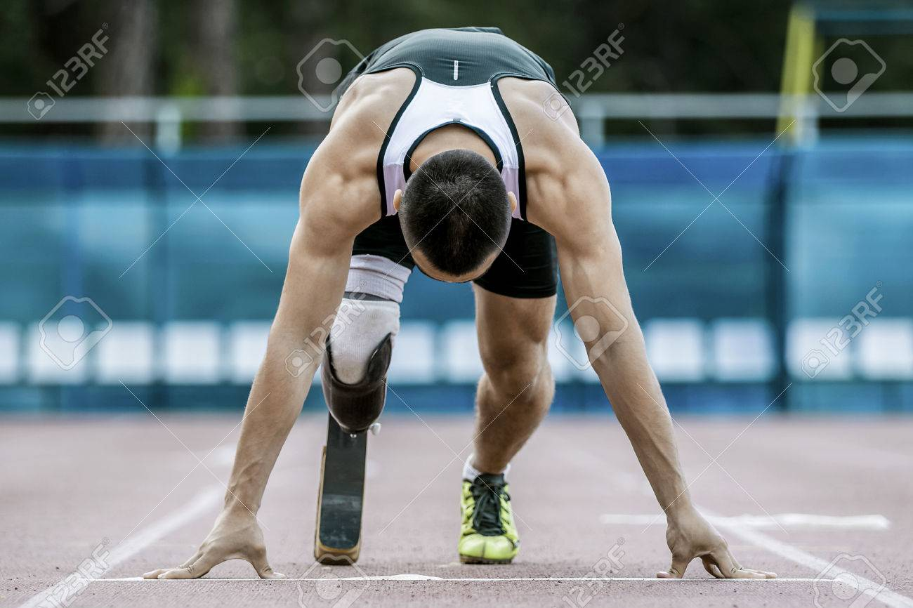 The disabled athlete preparing to start running - 45346651