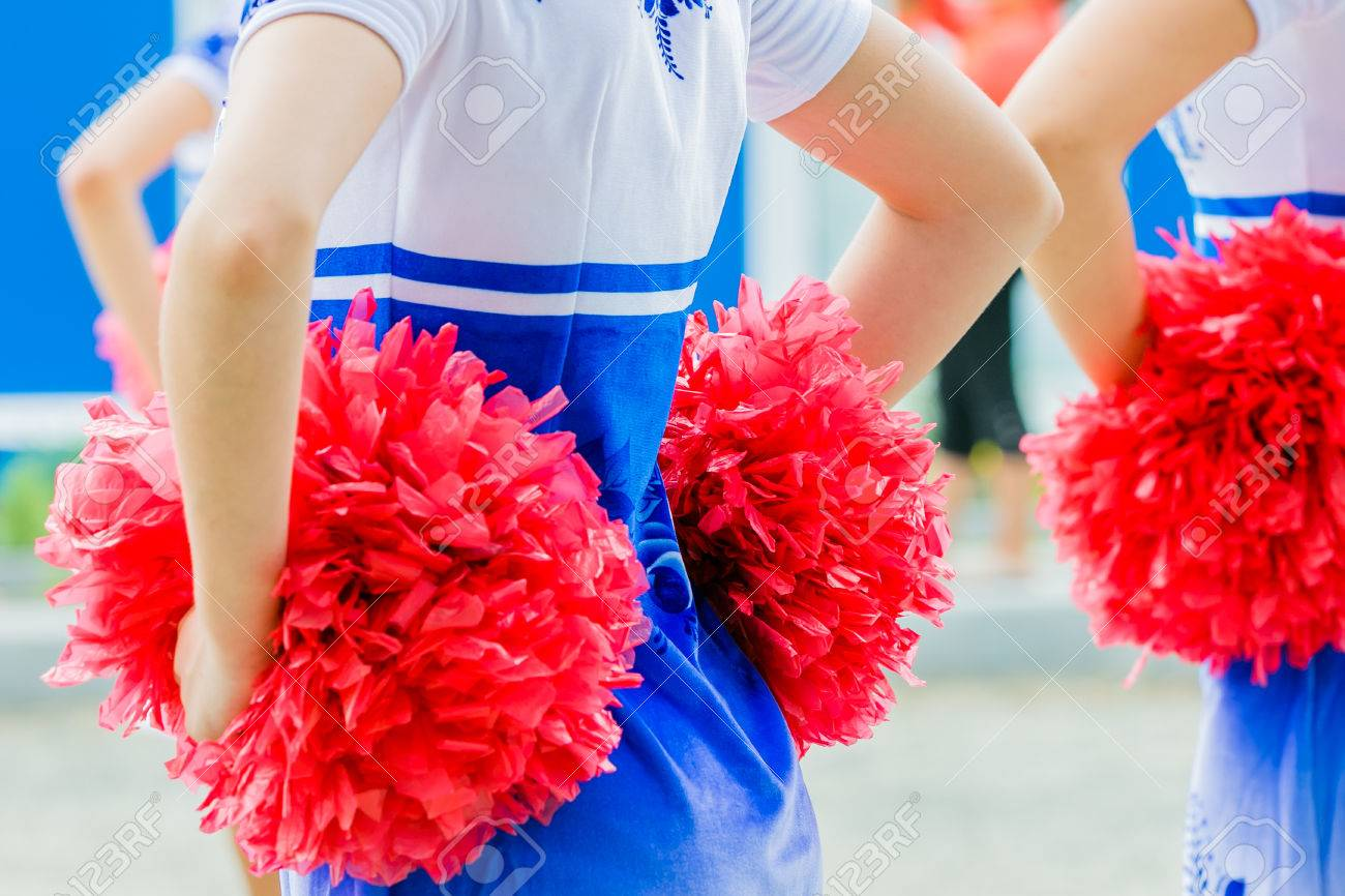 young female cheerleaders holding pom-poms during competitions - 45344344